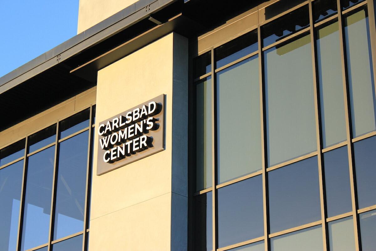 Carlsbad women center sign