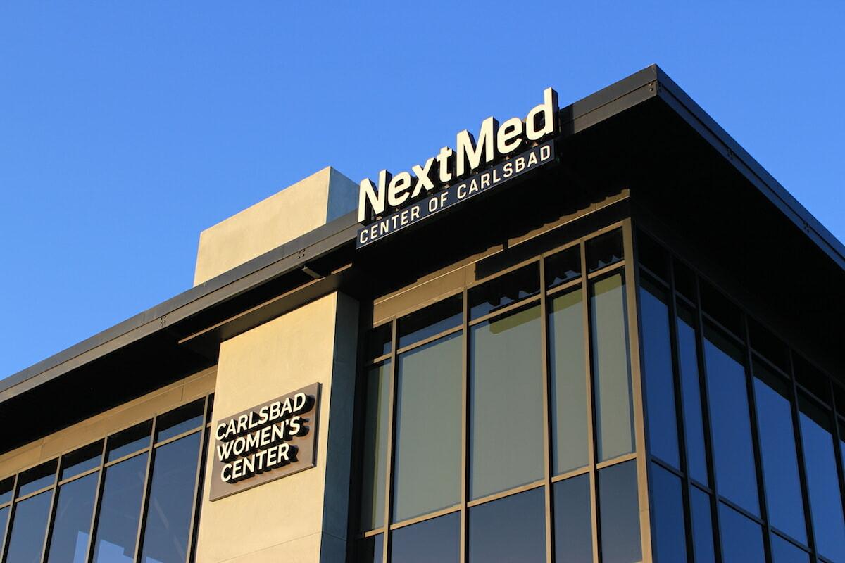 NextMed and Carlsbad women center branded sign