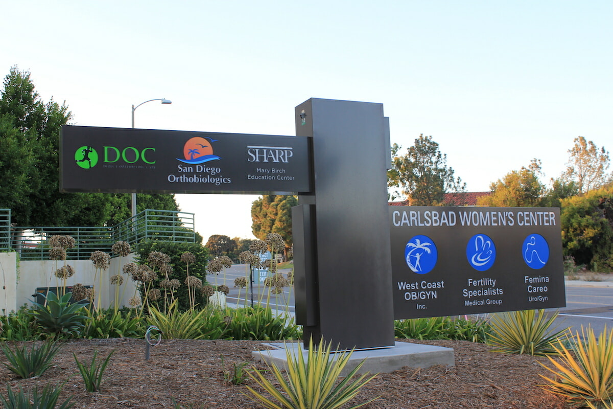 branded images on outdoor post close up