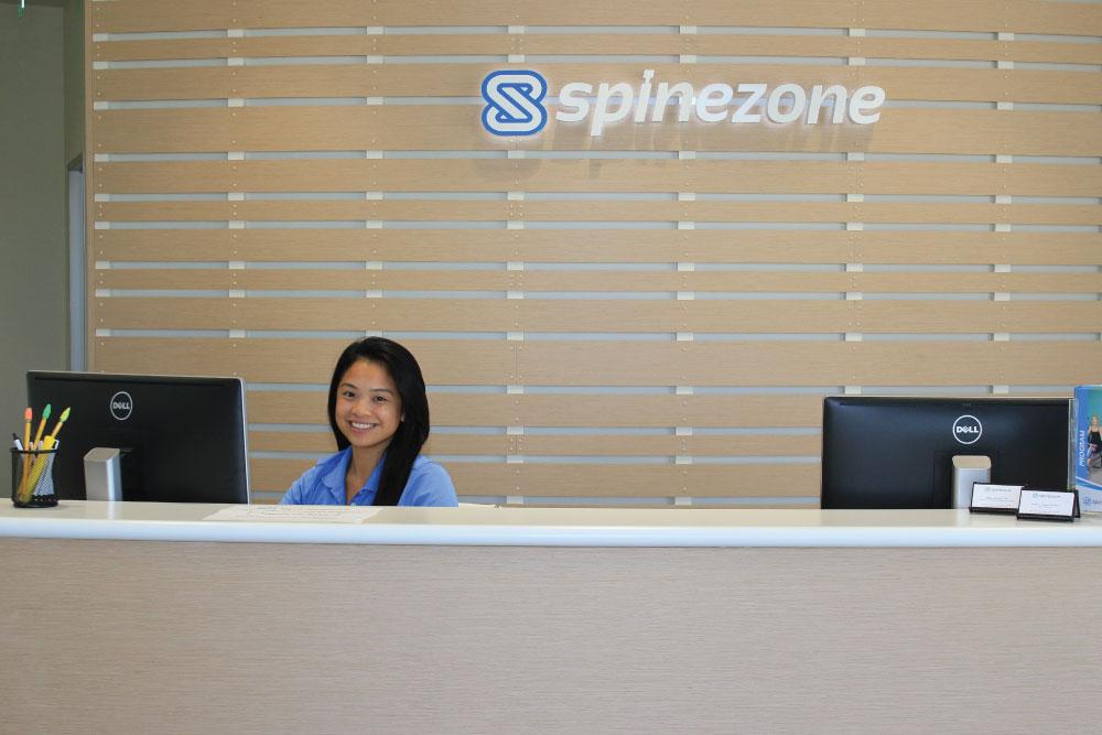 spinezone sign behind reception desk